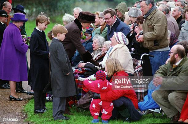 Diana Princess of Wales Prince William Prince Harry and Queen Elizabeth II meeting a crowd of wellwishers after attending a Christmas Day Service at...