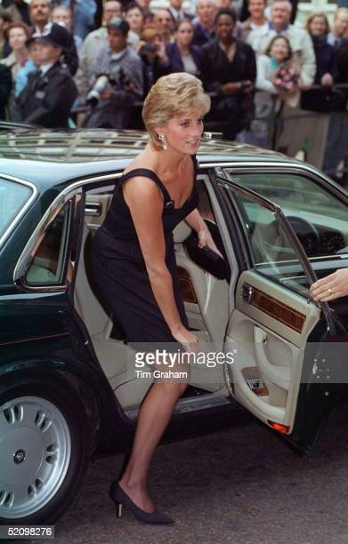 Diana, Princess Of Wales, Pulling Down The Hem Of Her Short Dress As She Alights Her Car For The Film Preview Of 'apollo 13' In London.