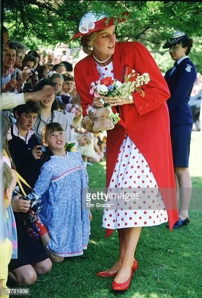 Diana, Princess of Wales receives flowers from well-wishers during a visit to the Royal Botanical Gardens in Melbourne, Australia