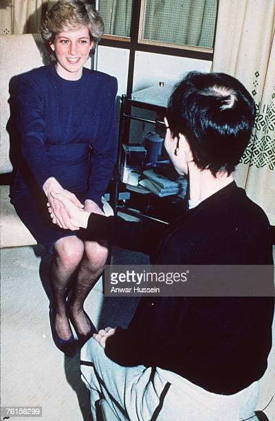 Diana Princess of Wales shakes hands with a Aids victim as she opens a new Aids ward at the Middlesex Hospital on April 9 1987 in London England