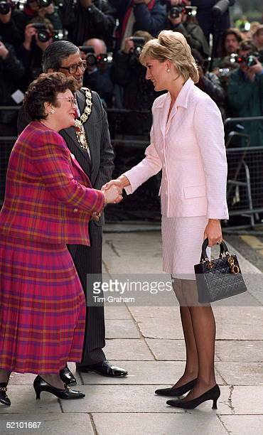 Diana, Princess Of Wales Shaking Hands As She Arrives At The National Hospital For Neurology And Neurosurgery In London. The Princess Is Wearing A...