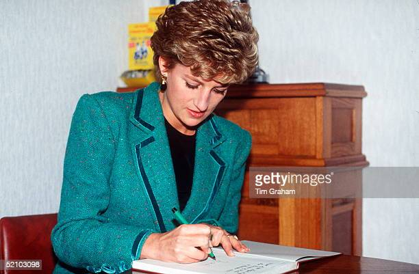 Diana, Princess Of Wales Signing A Visitors Book In Wales.