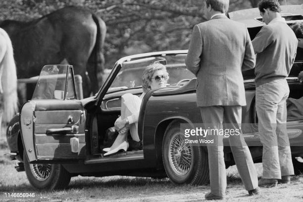 Diana Princess of Wales sits in a convertible car while attending a polo match UK 30th April 1984