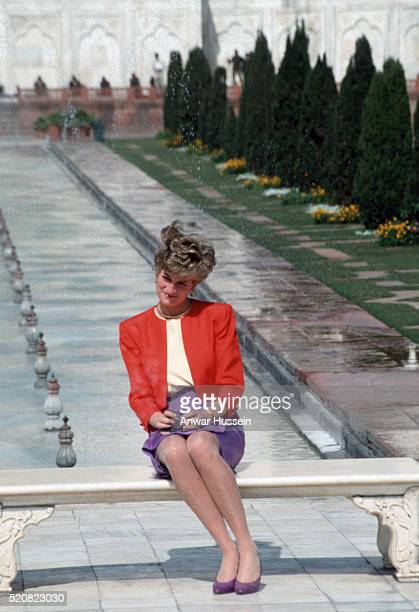 Diana Princess of Wales sits on a bench to pose alone at the Taj Mahal on February 11 1992 in Agra India Twelve years earlier her husband the Prince...