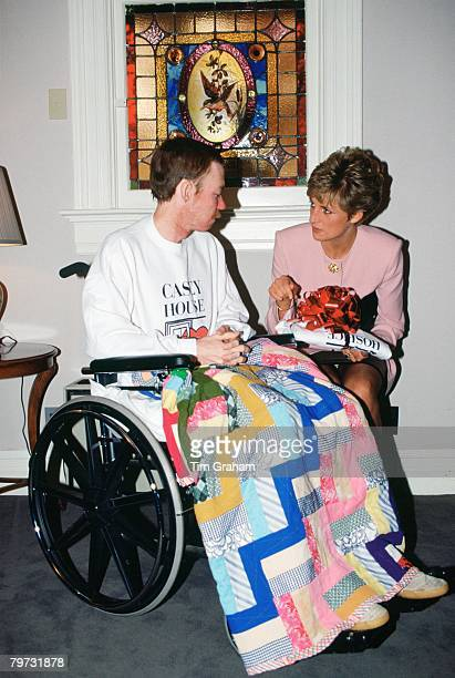 Diana Princess of Wales sits with one of the residents of Casey House an AIDS hospice in Toronto Canada