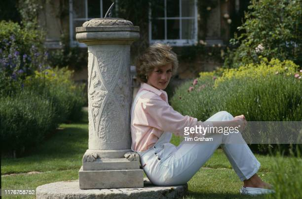 Diana, Princess of Wales sitting by a sundial at her home, Highgrove House, in Doughton, Gloucestershire, 18th July 1986.