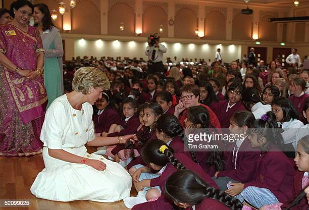 Diana Princess Of Wales Sitting Down On The Floor Whilst Talking To Pupils At The Swaminarayan School During Her Visit To The Shri Swaminarayan...