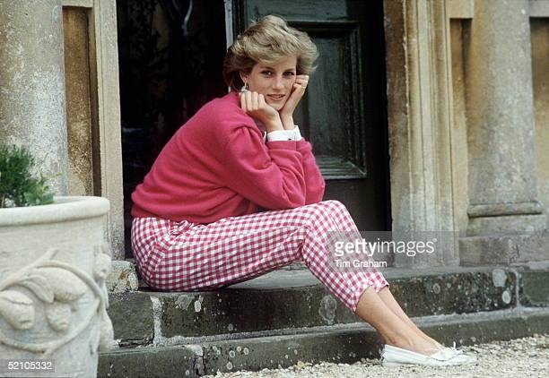 Diana, Princess of Wales sitting on a step at her home, Highgrove House, in Doughton, Gloucestershire, 18th July 1986.