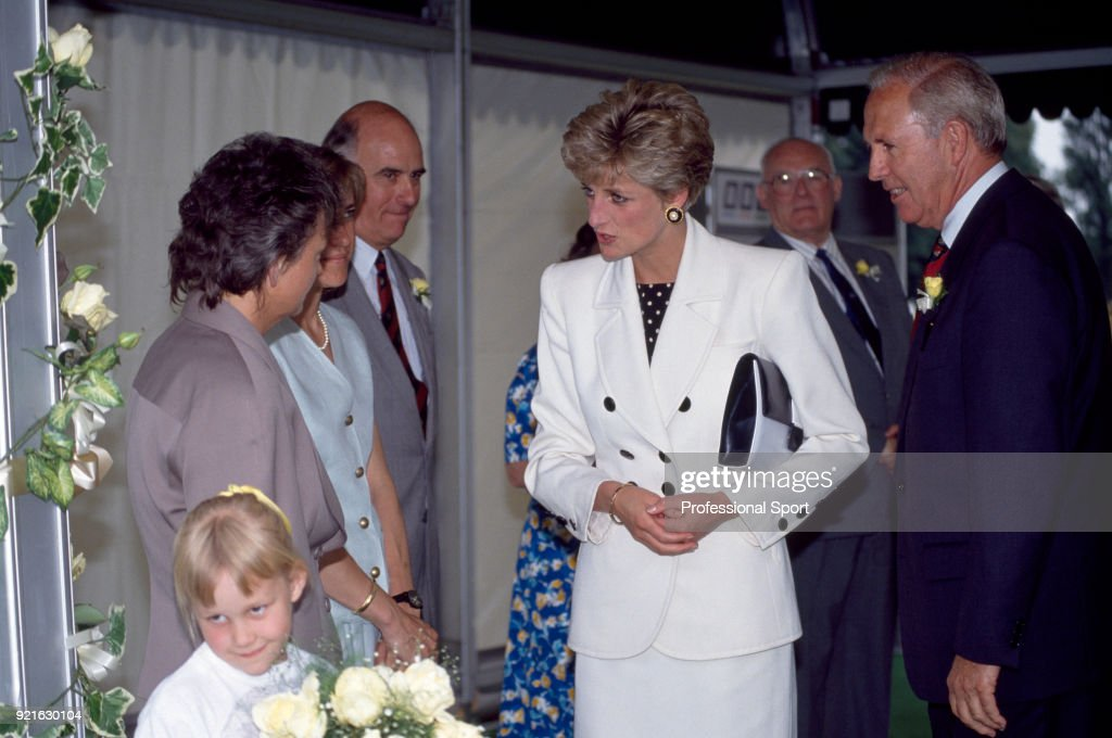 Diana, Princess of Wales (centre) speaking to the LTA National Women's Team Manager Sue Mappin (left) during the Federation Cup in Nottingham, England circa July 1991.