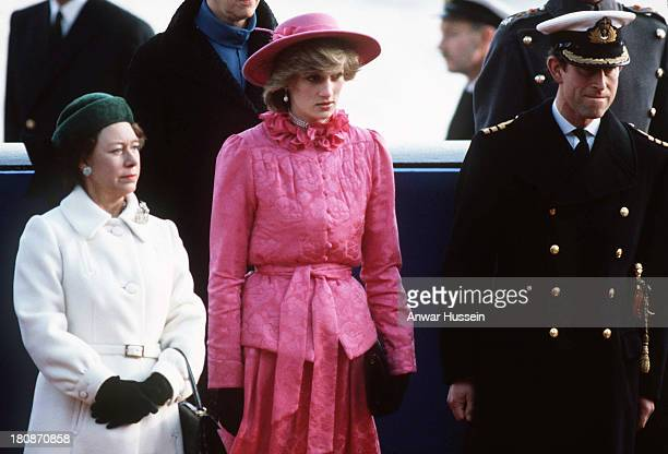 Diana Princess of Wales stands between Princess Margaret and Prince Charles Prince of Wales to await the arrival of Queen Beatrix of the Netherlands...