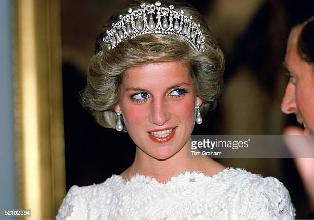 Diana Princess Of Wales Talking To Her Husband During A Visit To The British Embassy The Princess Is Wearing A Taffeta And Lace Gown With A Scalloped...