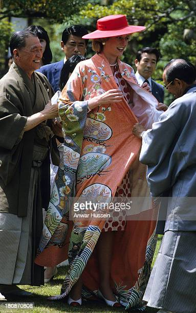 Diana Princess of Wales tries on a traditional kimono that she received as a gift at Nijo Castle Kyoto during an official visit to Japan on May 09...
