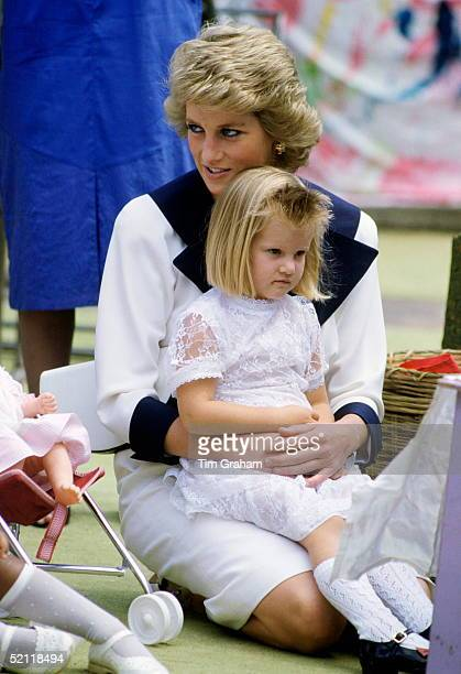 Diana Princess Of Wales Visiting A Barnado's Home During A Royal Tour In Australia She Is Sitting With A Little Girl On Her Lap