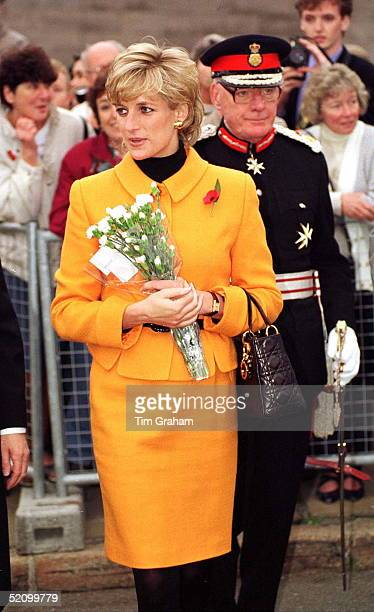 Diana Princess Of Wales Visiting Liverpool She Is Wearing A Bright Orange Suit Designed By Versace And Carrying A Christian Dior Handbag