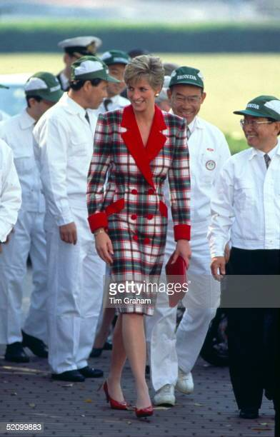 Diana Princess Of Wales Visiting The Honda Factory During Her Official Tour Of Japan Wearing A Tartan Coat Dress With Bright Red Accents Designed By...