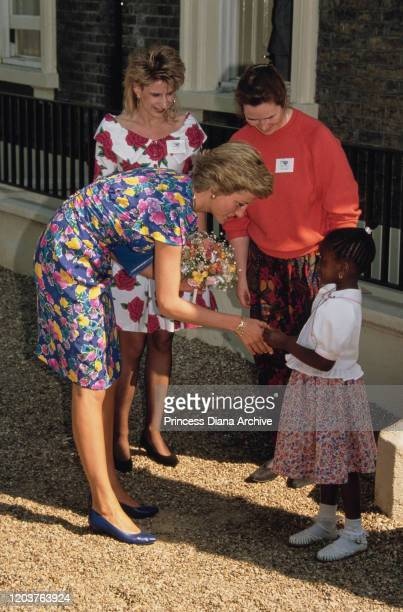 Diana Princess of Wales visits a centre for victims of drug abuse in Hackney London with two Turning Point charity workers May 1990 She is wearing a...