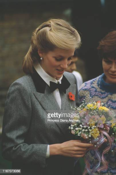 Diana Princess of Wales visits a Dr Barnardo's children's home in Newham London 1984 She is wearing a grey coat by Jan Van Velden