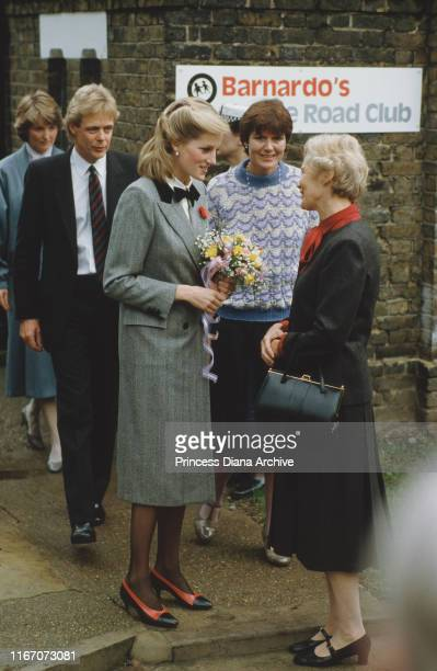 Diana, Princess of Wales visits a Dr Barnardo's children's home in Newham, London, 1984. She is wearing a grey coat by Jan Van Velden.