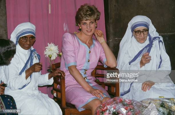 Diana, Princess of Wales visits a home run by Mother Teresa for abandoned children in Calcutta , India, 15th February 1992. She is wearing a pink...