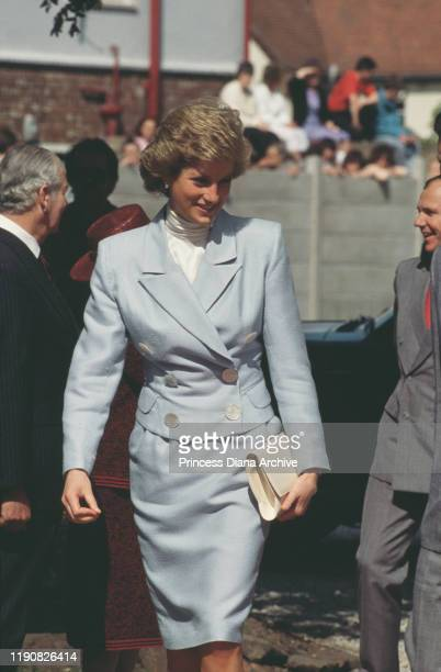Diana, Princess of Wales visits a Shell Lubricants Centre in Chester, England, May 1988. She is wearing a suit by Arabella Pollen.