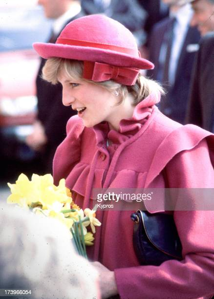Diana Princess of Wales visits Chinatown in Liverpool April 1982 She is pregnant with Prince William and wearing a pink wool maternity coat by...