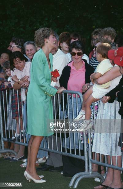 Diana, Princess of Wales visits Dorchester, UK, July 1991. She is wearing a green coat-dress by Catherine Walker.