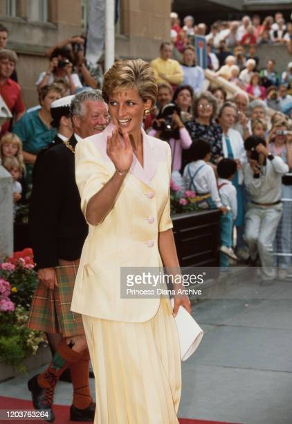 Diana, Princess of Wales visits Inverness in Scotland, July 1990. She is wearing a pink and yellow suit by Catherine Walker.