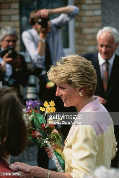Diana Princess of Wales visits Inverness in Scotland July 1990 She is wearing a pink and yellow suit by Catherine Walker