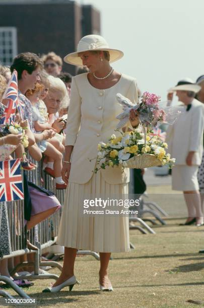 Diana Princess of Wales visits RAF Cranwell in Lincolnshire UK July 1991 She is wearing a suit by Catherine Walker and a Philip Somerville hat