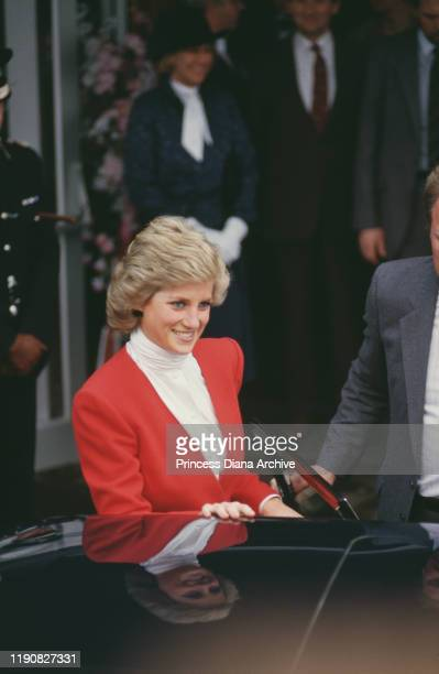 Diana, Princess of Wales visits Rugby in England, wearing a red suit by Catherine Walker, 23rd March 1988.