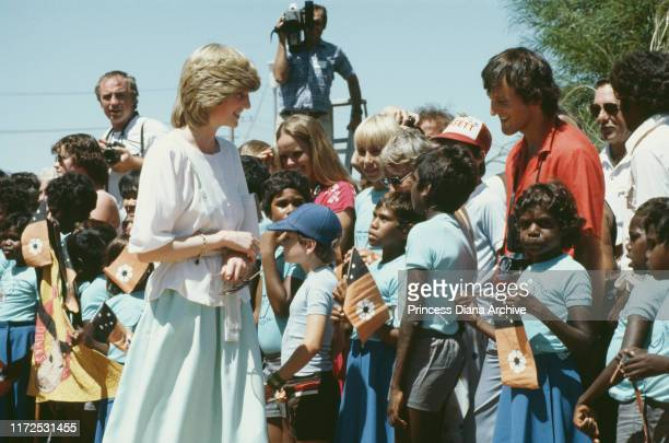 Diana Princess of Wales visits Tennant Creek in the Northern Territory of Australia March 1983 Some of the children are holding the flag of the...