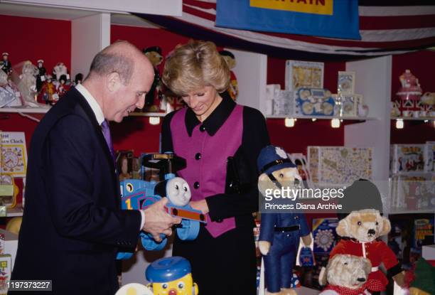 Diana, Princess of Wales visits the Britain section of the toy shop FAO Schwarz in New York City, February 1989. She is wearing a pink and black suit...