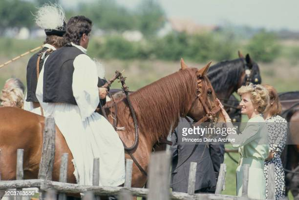 Diana Princess of Wales visits the Bugac puszta in the Kiskunsag National Park Hungary May 1990 Diana is wearing a pale green dress by Catherine...