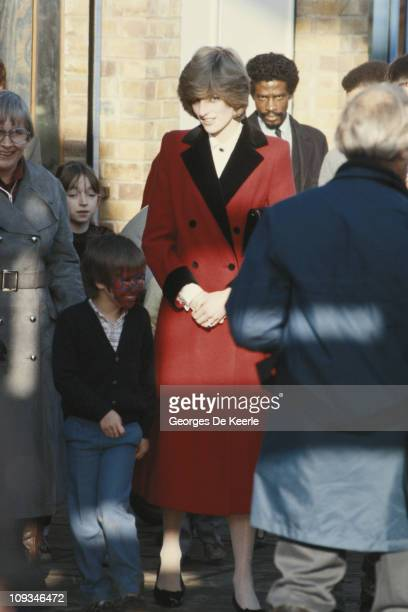 Diana Princess of Wales visits the Charlie Chaplin playground in Kennington south London 9th December 1982 She is wearing a red coat by Catherine...