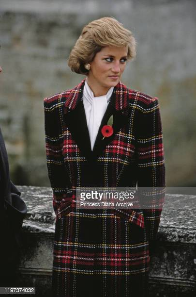 Diana, Princess of Wales visits the Château de Chenonceau on the River Cher in France, November 1988. She is wearing a tartan coat-dress by Catherine...