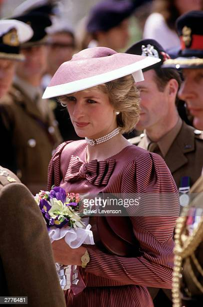 Diana Princess of Wales visits the Commonwealth War Graves in April 1985 in Anzio Italy during the Royal Tour of Italy Diana wore a dress designed by...