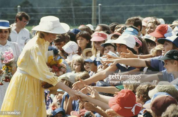 Diana, Princess of Wales visits the Ginger Factory in Yandina, Queensland, Australia, 12th April 1983. She is wearing a yellow dress by Jan Van...