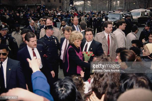 Diana Princess of Wales visits the Henry Street Settlement on the Lower East Side in New York City February 1989 She is wearing a pink and black suit...