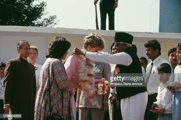 Diana, Princess of Wales visits the Norpoor Family Welfare Centre in Islamabad, Pakistan, September 1991. She is wearing a pink and blue dress by...