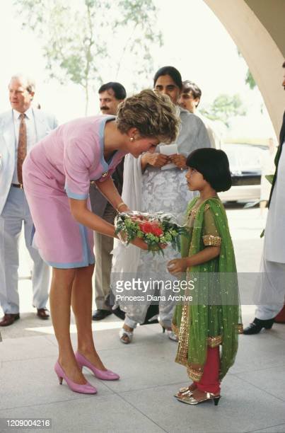 Diana, Princess of Wales visits the Pakistan Women's Association in Islamabad, Pakistan, September 1991. She is wearing a pink and blue dress by...