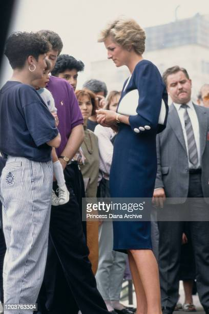 Diana Princess of Wales visits the Peto Institute for children with cerebral palsy in Budapest Hungary May 1990 She is wearing a blue and white dress...