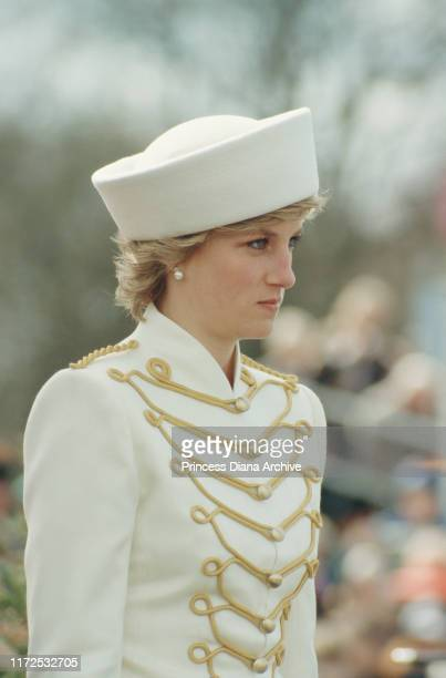 Diana, Princess of Wales visits the Royal Military Academy Sandhurst in Berkshire, UK, wearing a white military-style Catherine Walker suit and a...