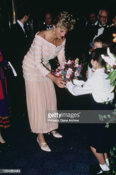 Diana, Princess of Wales visits the Savoy Theatre in London for its official reopening after its restoration, 19th July 1993. Her pink silk dress...