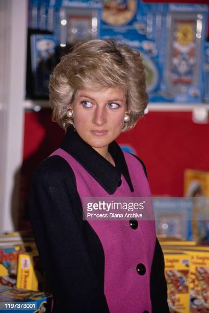Diana, Princess of Wales visits toy shop FAO Schwarz in New York City, February 1989. She is wearing a pink and black suit by Catherine Walker.
