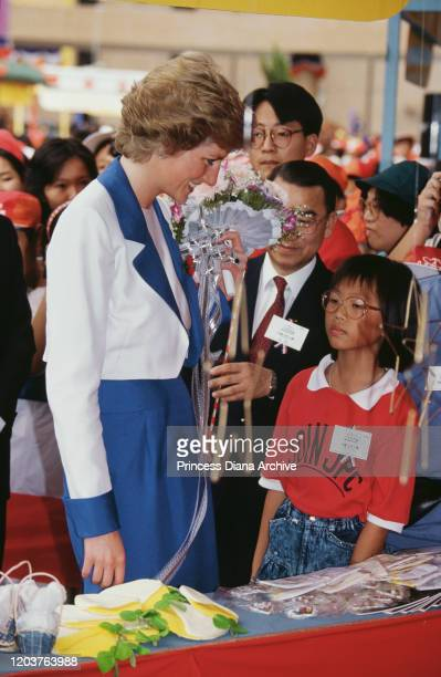Diana, Princess of Wales visits Tuen Mun in the New Territories of Hong Kong, November 1989. She is wearing a blue and white suit by Catherine Walker...