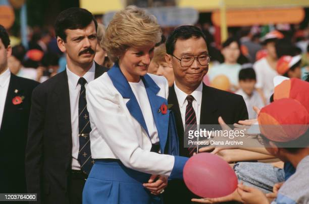 Diana Princess of Wales visits Tuen Mun in the New Territories of Hong Kong November 1989 She is wearing a blue and white suit by Catherine Walker...