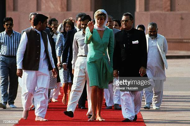 Diana Princess of Wales walks with bare feet and covers her head with a headscarf as she visits the Badshahi Mosque on September 25 1991 in Lahore...