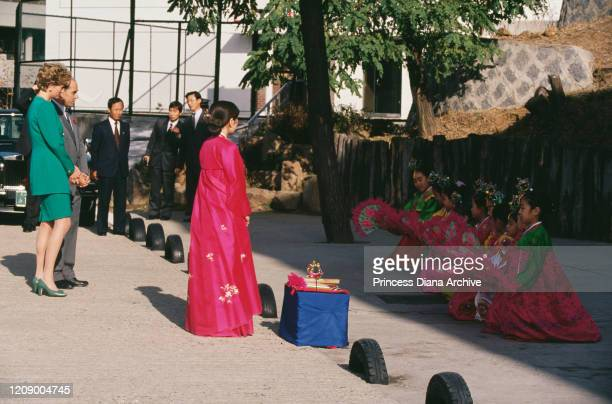 Diana, Princess of Wales watches a dance performed by children at the British School in Seoul, South Korea, 4th November 1992.