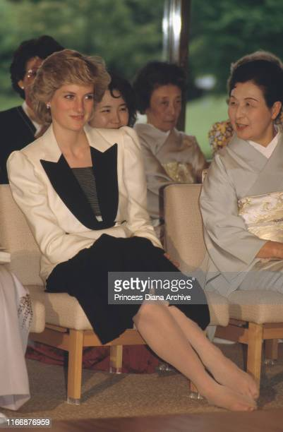 Diana, Princess of Wales watches a demonstration of traditional Japanese flower arranging or ikebana at the Akasaka Palace in Tokyo, Japan, May 1986....