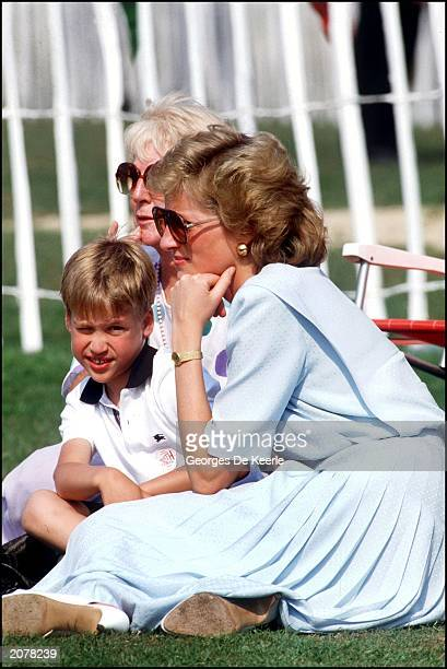 Diana Princess of Wales watches the Cartier Polo Trophy match with Prince William on July 7 1989 in Windsor England Prince William celebrates his...
